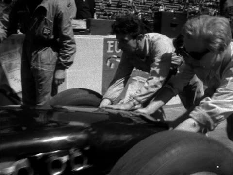 monaco grand prix: practise runs on the circuit; monaco: monaco harbour: ext general view of monaco bay stirling moss talking a man / moss pushed off... - general view stock videos & royalty-free footage