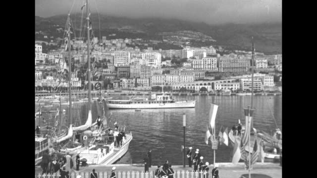 monaco's port hercule filled with boats with the hills of the principality in the distance / aerial of the port / ms the yacht deo juvante slowly... - royal palace monaco stock videos and b-roll footage