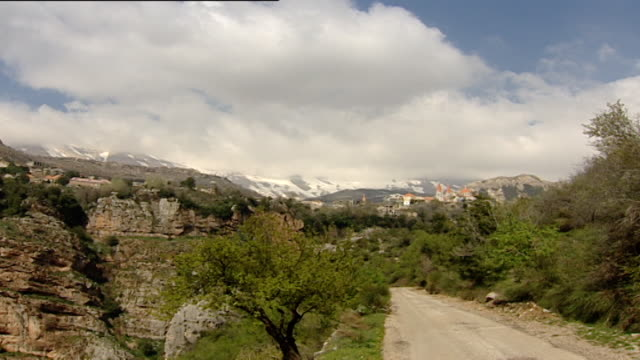 monastery of mar lishaa, qadisha valley. pan from a view of mar seba cathedral in bsharri to the medieval monastery shared by two christian... - canyon stock videos & royalty-free footage