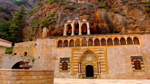 monastery of saint anthony of qozhaya. low angle view of church courtyard and bell tower. - canyon stock videos & royalty-free footage
