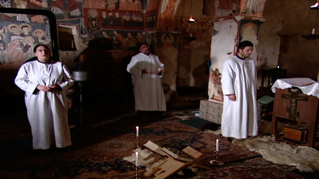 monastery of saint moses the abyssinian syriac clergy recite prayer in spiritual contemplation in a 6th century church paolo dall oglio was kidnapped... - circa 6th century stock videos & royalty-free footage