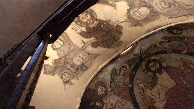 vidéos et rushes de monastery of st. anthony. low angle view of a medieval fresco of christ pantocrator. in the eastern apse. built in 300 ce the monastery is the oldest... - byzantin