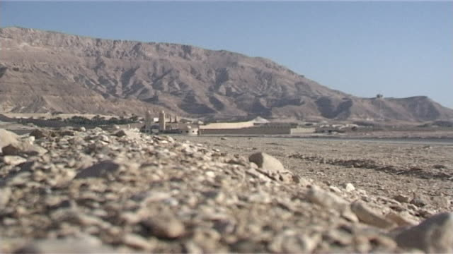 monastery of st. anthony. low-angle view of the eastern desert terrain surrounding the monastery. - 尖塔点の映像素材/bロール