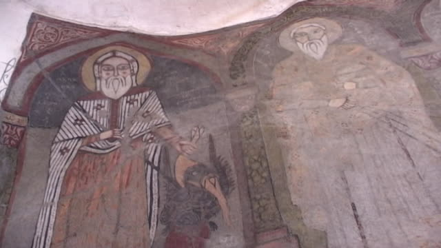 vidéos et rushes de monastery of st. anthony. on a fresco of pakaou holding the devil sofonesar by his yellow hair. built in 300 ce the monastery is the oldest in the... - byzantin