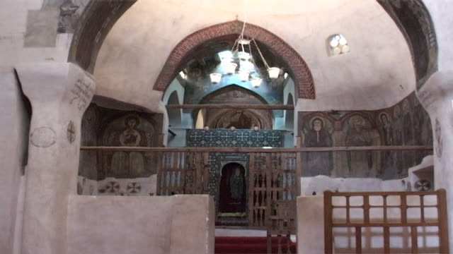 monastery of st. anthony. view of the central sanctuary with its murals, small apse and iconostasis. built in 300 ce the monastery of st. anthony is... - apse stock videos & royalty-free footage