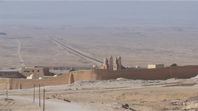 monastery of st anthony view of the walled ancient coptic orthodox monastery surrounded by the eastern desert - solitude stock videos & royalty-free footage