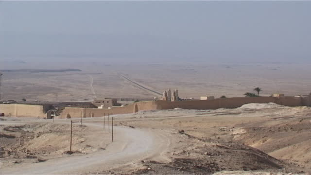 monastery of st anthony wide view of the walled ancient coptic orthodox monastery surrounded by the eastern desert - solitude stock videos & royalty-free footage