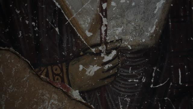 monastery of the cross. on a medieval byzantine style fresco depicting a saint's hand holding a staff. - 新約聖書点の映像素材/bロール