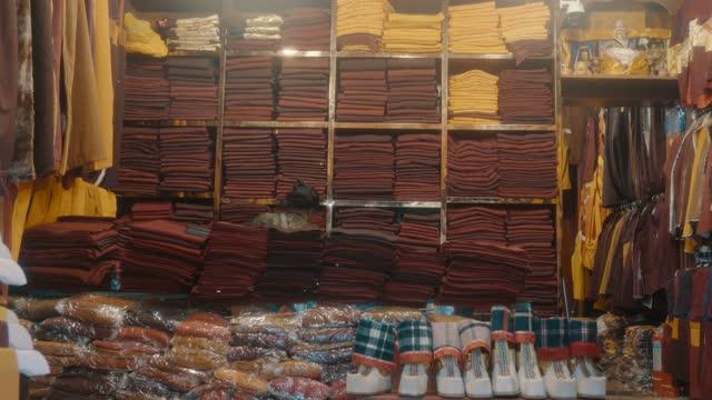 monastic supplies shop,tibet,china. - straßenschild stock-videos und b-roll-filmmaterial