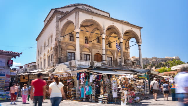 ws monastiraki square entrance to flea market and tzistarakis mosque - schuhwerk stock-videos und b-roll-filmmaterial