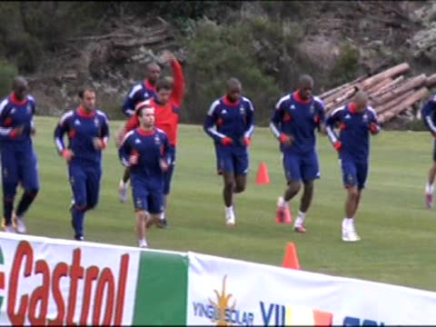 Monday a day after they went on strike over the expulsion of forward Nicolas Anelka The 21man squad jogged round the pitch while embattled coach...