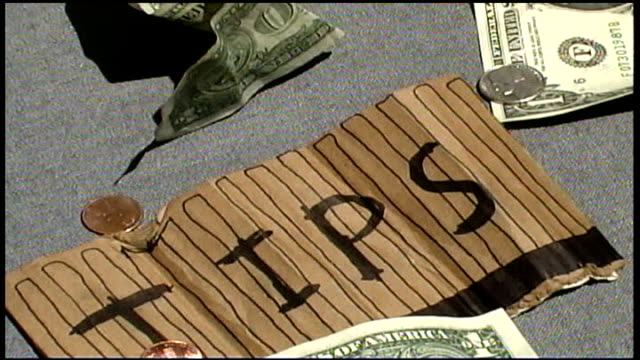 money and change being thrown on top of tips sign - financial accessory stock videos and b-roll footage