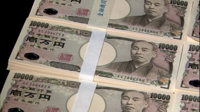 Money bands hold together bundles of ten thousand yen bills in Tokyo, Japan.