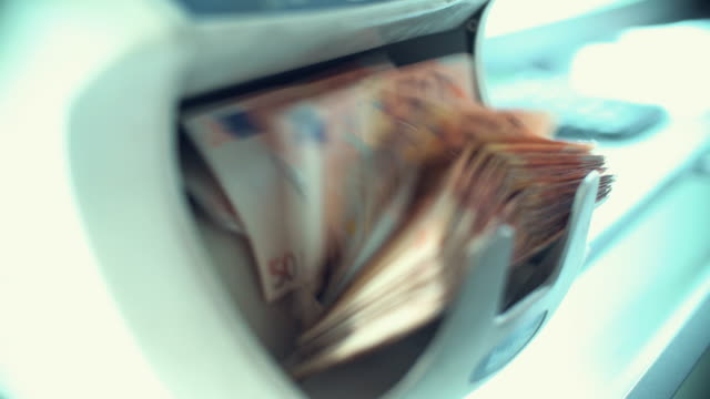 money counter fed with 50 euro bills. - checkout stock videos and b-roll footage
