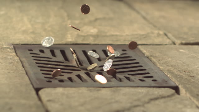 money down the drain - high speed various english coins falling on and in to road drain, wide - verlust stock-videos und b-roll-filmmaterial