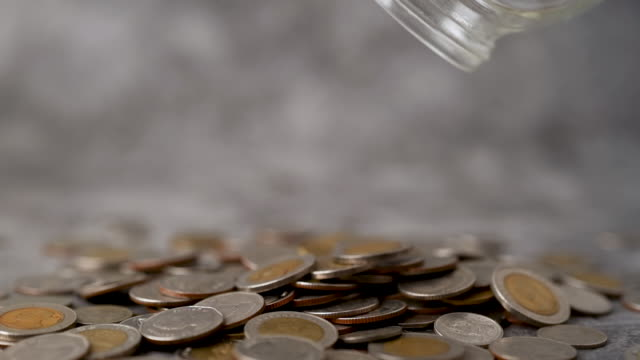 vídeos de stock e filmes b-roll de money drop slow motion, the concept of saving money for the future and financial advancement - capital letter