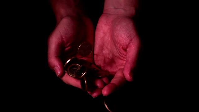 money dropping into hands on black background - money makes the world go around stock videos and b-roll footage