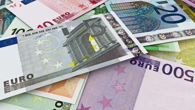 Money euro. Camera pan above stacks of euro