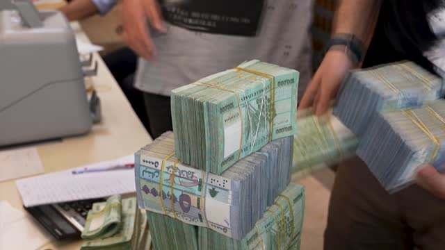 money exchangers change currencies for customers in beirut a day after the lebanese pound hit a new low against the us dollar on the black market - democracy stock videos & royalty-free footage