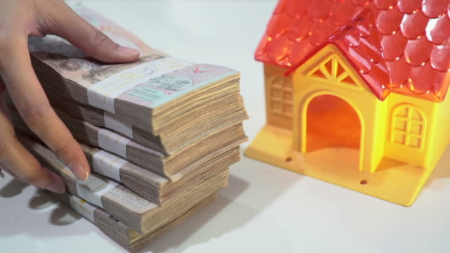 money for house - banknote stock videos & royalty-free footage