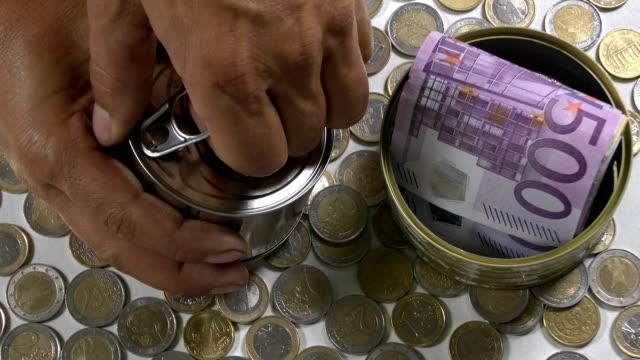 money from tin - papiergeld stock videos & royalty-free footage