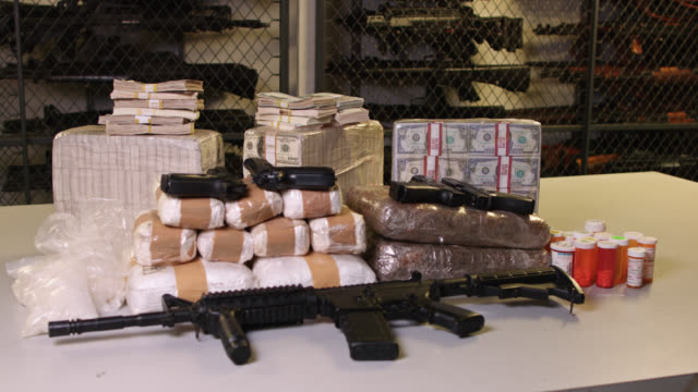 money, guns and drugs in police evidence room - crime or recreational drug or prison or legal trial stock videos & royalty-free footage