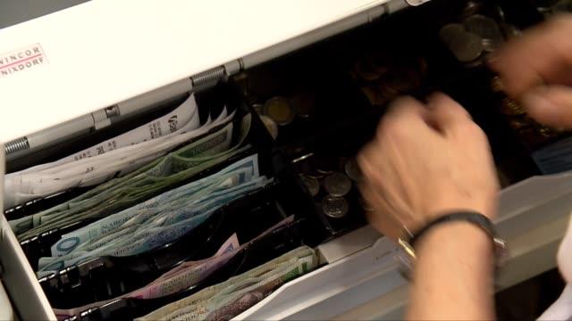 money in cash register - geldmünze stock-videos und b-roll-filmmaterial