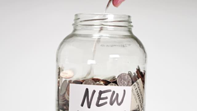 money jar - jar stock videos & royalty-free footage