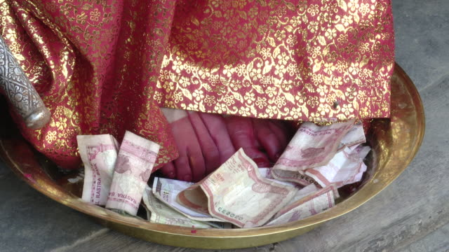 Money offered to the feet of Kumari dev, close up