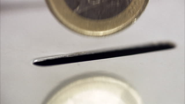 stockvideo's en b-roll-footage met money put into a savings box. - european union coin
