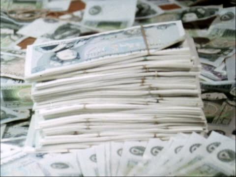 int five pound notes dropped in pile bundles of cash bank notes in basket - stack stock videos & royalty-free footage