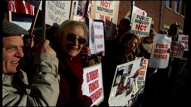 NHS money used to silence potential whistleblowers T02110926 Relatives of some of those who died at Stafford Hospital protesting with placards...