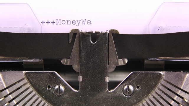 hd moneywatch business markets typed  on an old typewriter - newspaper page stock videos and b-roll footage