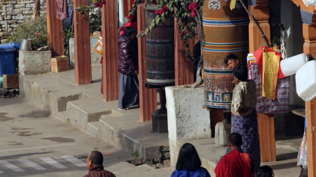 people on the main road of mongar - asian tribal culture stock videos and b-roll footage