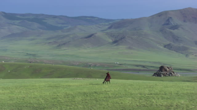 mongolia: horsewoman riding - independent mongolia stock videos & royalty-free footage