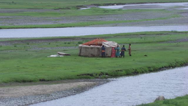 Mongolia: Mongolian people making a yurt