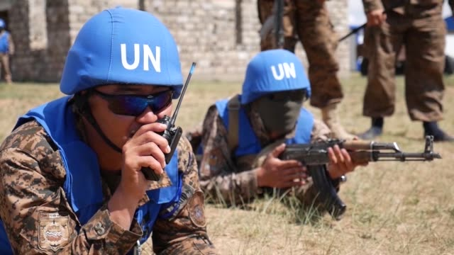 mongolian armed forces peacekeepers navigate the khaan quest 2018 cordon and search lane june 18 at five hills training area mongolia the purpose of... - united nations stock videos & royalty-free footage