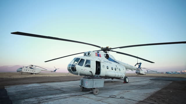 ms mongolian mi-8 helicopter on landing pad being fueled / suhbaatar, mongolia, mongolia - refuelling stock videos & royalty-free footage