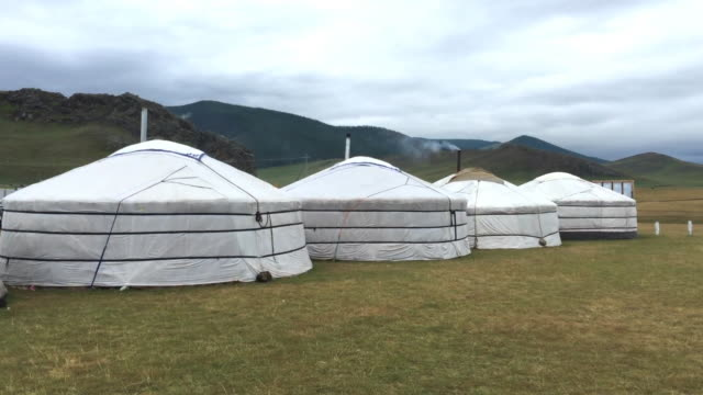 mongolian yurts with steaming chimneys at orkhon valley cultural landscape in mongolia - independent mongolia stock videos & royalty-free footage