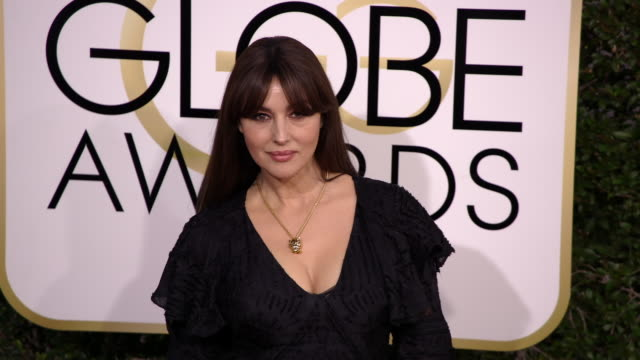 monica bellucci at 74th annual golden globe awards arrivals at 74th annual golden globe awards arrivals at the beverly hilton hotel on january 08... - feierliche veranstaltung stock-videos und b-roll-filmmaterial