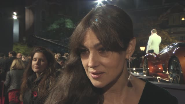interview monica bellucci on the attraction of 'bond' working with sam mendes her scenes with daniel craig at 'spectre' world premiere at royal... - daniel craig stock videos and b-roll footage
