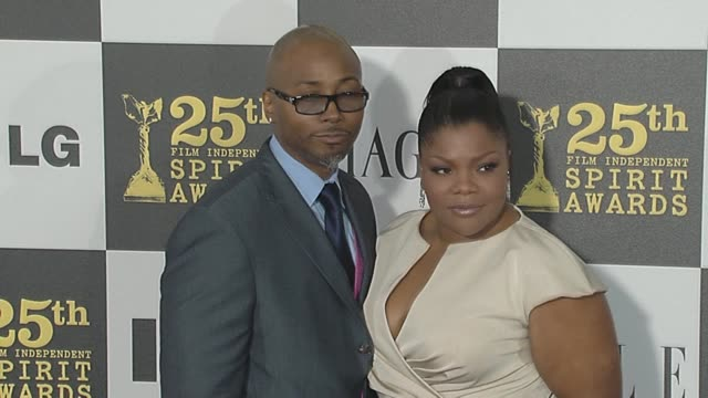 mo'nique and sidney hicks at the 2010 film independent's spirit awards - arrivals at los angeles ca. - independent feature project video stock e b–roll