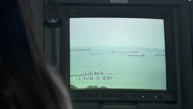 A monitor shows ships in a sea lane.