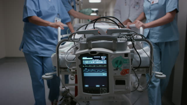 ds monitoring signs of a patient on a gurney going to the or - medical equipment stock videos & royalty-free footage