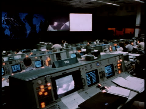 Monitors display information in Houston's NASA control room.