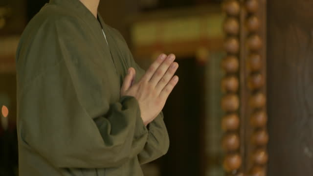 monk in japanese temple chion-ji. - temple body part stock videos and b-roll footage