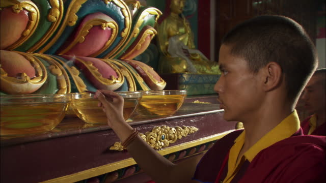 a monk performs a ritual with incense at an altar. available in hd. - altar stock videos & royalty-free footage