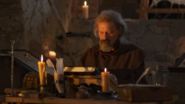 hd: monk reading a book in monastery - candlelight stock videos & royalty-free footage