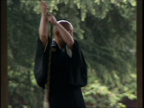 monk ringing a gong at a temple in japan - 1990 stock videos & royalty-free footage