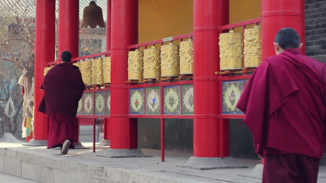 ms monk turning prayer wheel  in the lama temple/xian,shaanxi,china - chinese culture stock videos & royalty-free footage